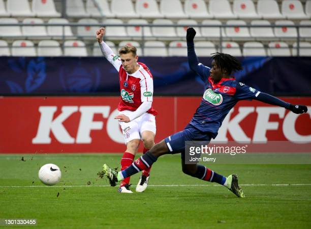Kaj Sierhuis of Reims, Ismael Doukoure of Valenciennes during the French Cup match between Stade Reims and Valenciennes FC at Stade Auguste Delaune...
