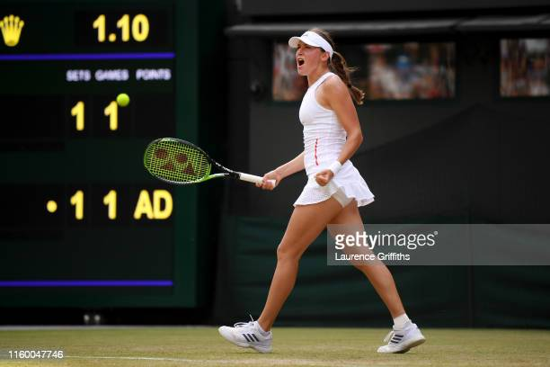 Kaja Juvan of Slovenia celebrates in her Ladies' Singles second round match against Serena Williams of The United States during Day four of The...