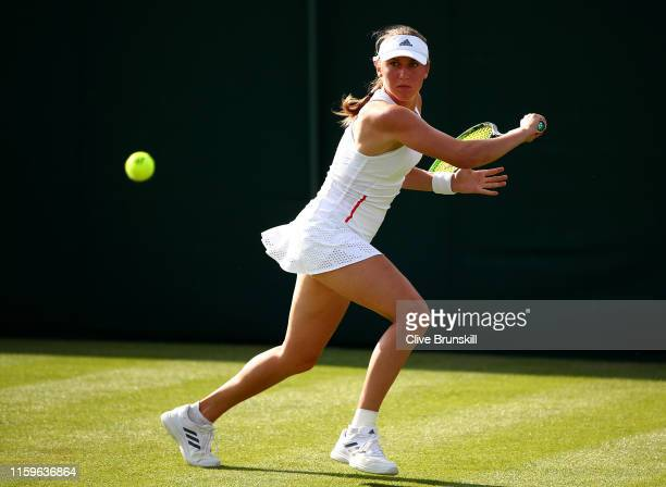 Kaja Juvan of Slovenia plays a backhand in her Ladies' Singles first round match against Karolina Pliskova of The Czech Republic during Day two of...