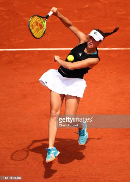 Kaja Juvan of Slovenia plays a forehand during her ladies singles first round match against Sorana Cirstea of Romania during Day two of the 2019...