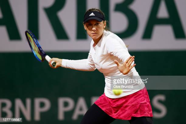 Kaja Juvan of Slovenia plays a forehand during her Women's Singles first round match against Angelique Kerber of Germany on day two of the 2020...