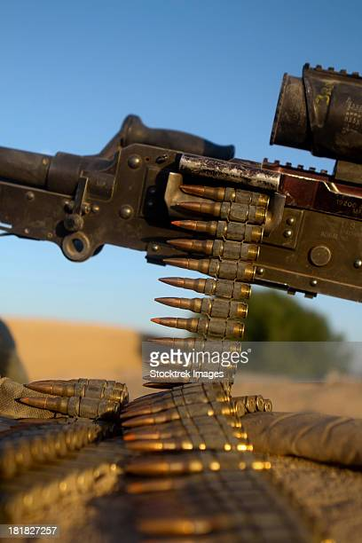 kajaki, afghanistan, june 2, 2012 - rounds of a m240 machine gun are spread out over a compound roof. - ammunition magazine stock photos and pictures