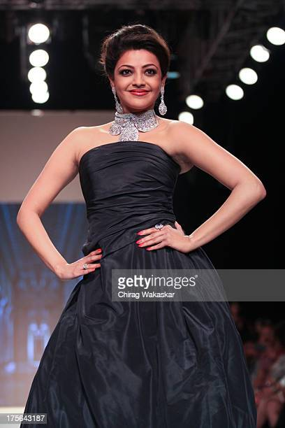 Kajal Aggarwal walks the runway at the Moni Agarwal show on day 2 of India International Jewellery Week 2013 at the Hotel Grand Hyatt on August 5...