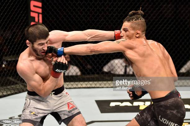Kajan Johnson of Canada and Rustam Khabilov of Russia exchange punches in their lightweight bout during the UFC Fight Night event at Olimpiysky Arena...