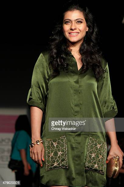 Kajol Devgan poses for pictures at day 5 of Lakme Fashion Week Summer/Resort 2014 at the Grand Hyatt on March 15 2014 in Mumbai India