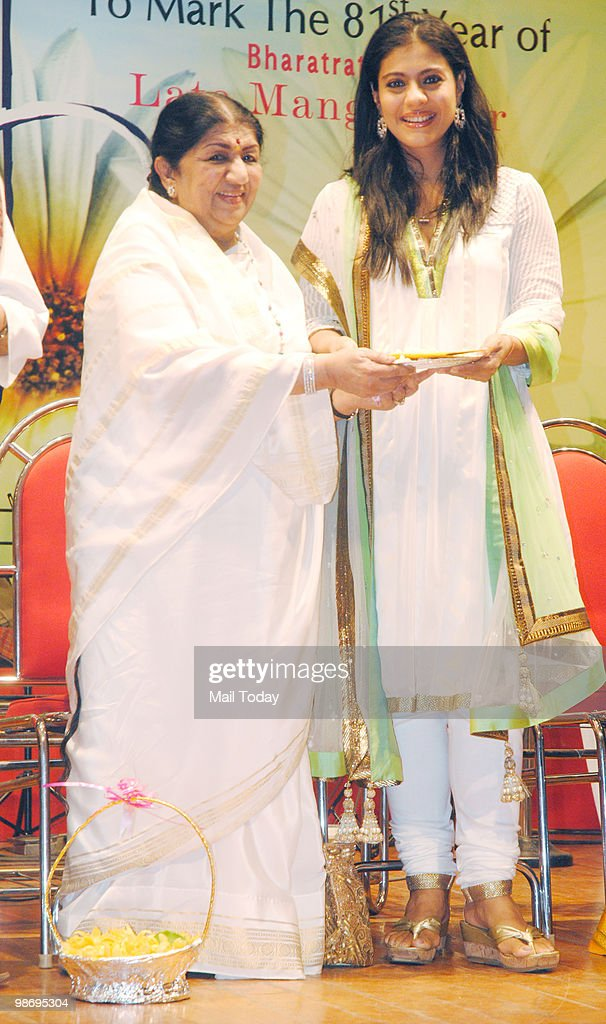 Kajol receives an award from Lata Mangeshkar at the Deenanath Mangeshkar Awards in Mumbai on Sunday April 25 2010
