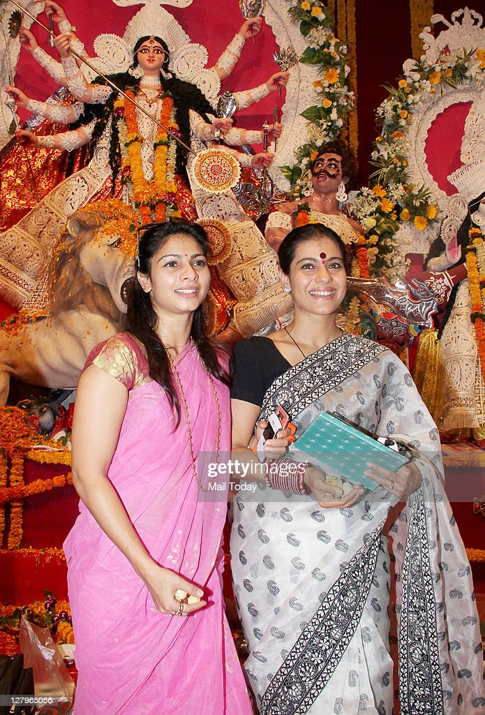 Kajol with sister Tanisha Mukherjee arrives to celebrate `Durga Puja` at Balkanji Bari Santacruz Mumbai on Monday 3rd October 2011