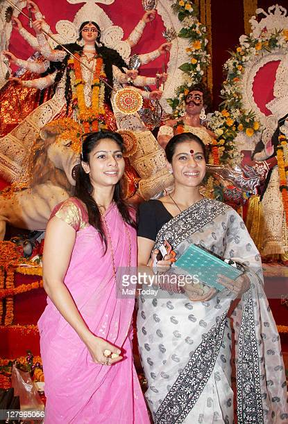 Kajol with sister Tanisha Mukherjee arrives to celebrate 'Durga Puja' at Balkanji Bari, Santacruz, Mumbai on Monday 3rd October, 2011.