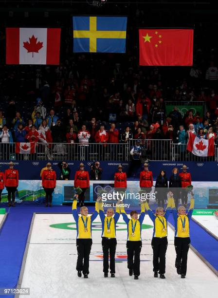 Kajsa Bergstroem, Anna Le Moine, Cathrine Lindahl, Eva Lund and Anette Norberg of Sweden celebrate winning the gold medal after their victory over...