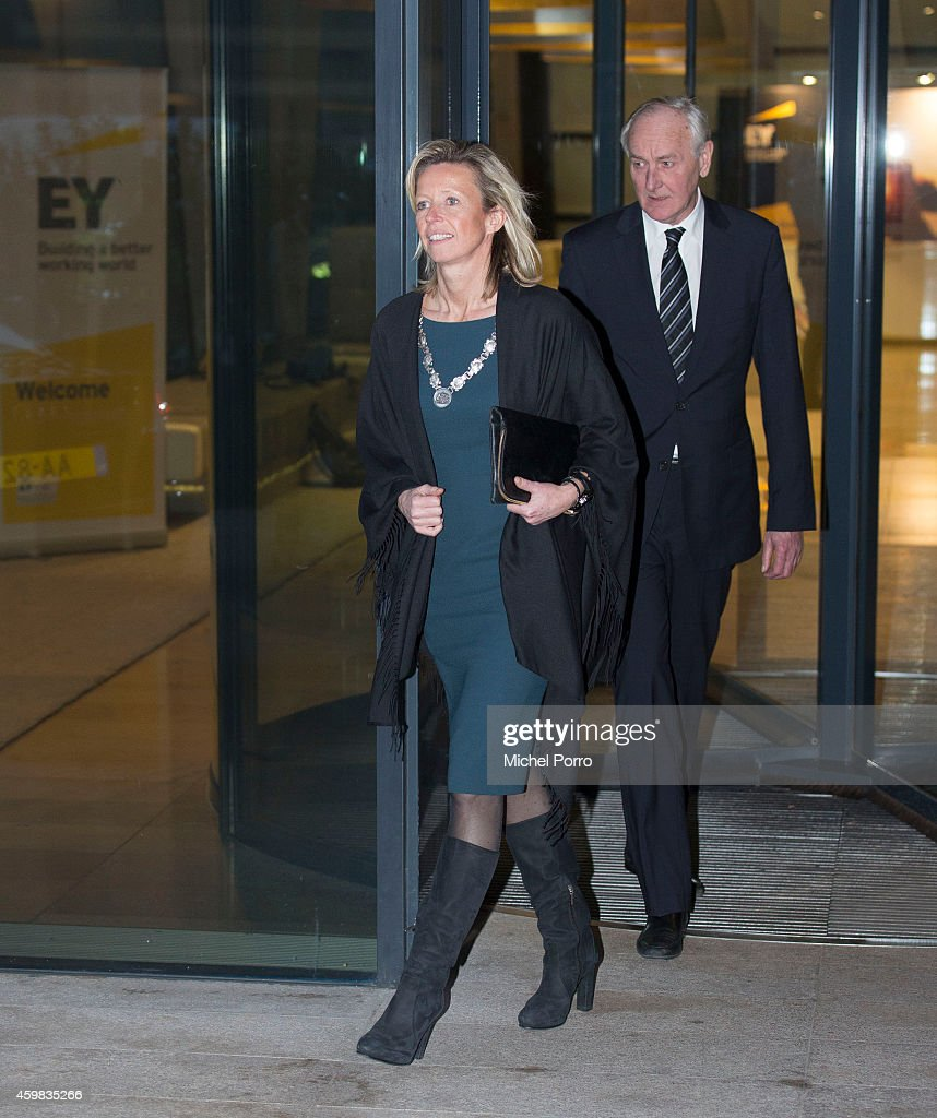 Kajsa Ollongren and Johan Remkes leave after attending the presentation ceremony of the Dutch Sustainable Growth Report on December 2, 2014 in Amsterdam The Netherlands.