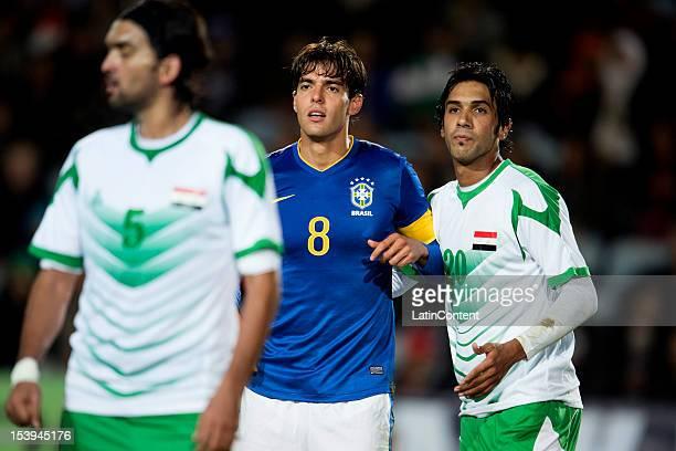 Kaká of Brazil and Nashaat Akram Muthana Khalid of Iraq during a FIFA friendly match between Brazil and Iraq at Swedbank Stadium on October 10 2012...