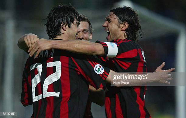 Kaka Andriy Schevchenko and Paolo Maldini of Milan celebrate a goal during the Serie A match between Siena and AC Milan played at the Artemio Franchi...