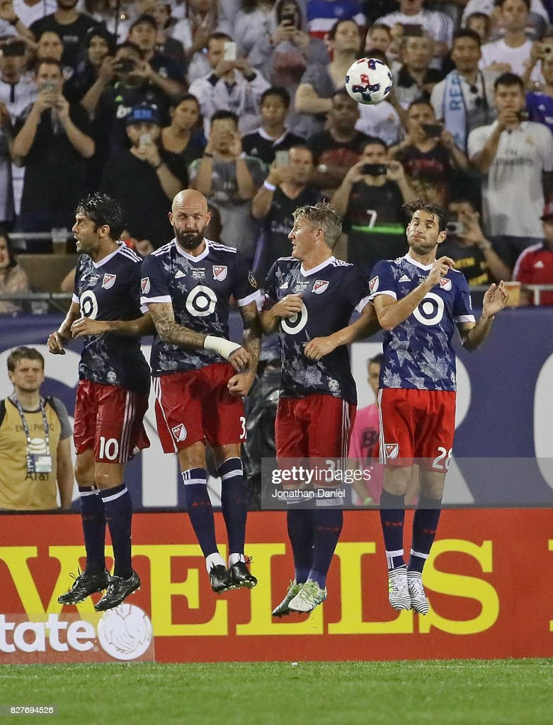 Kaka #10, Jelle Van Damme #37; Bastian Schweinsteiger #31 and Ignacio Piatti #28 leap to try and block a free kick against Real Madrid during the 2017 MLS All- Star Game at Soldier Field on August 2, 2017 in Chicago, Illinois. Real Madrid defeated the MLS All-Stars 4-2 in a shootout following a 1-1 regulation tie.