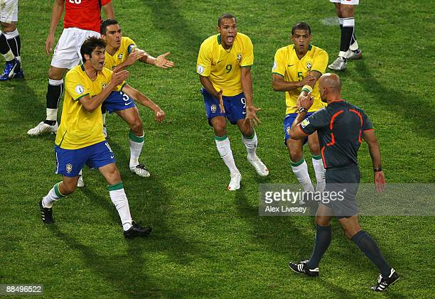 Kaka Lucio Luis Fabiano and Felipe Melo of Brazil appeal for handball to referee Howard Webb during the FIFA Confederations Cup match between Brazil...
