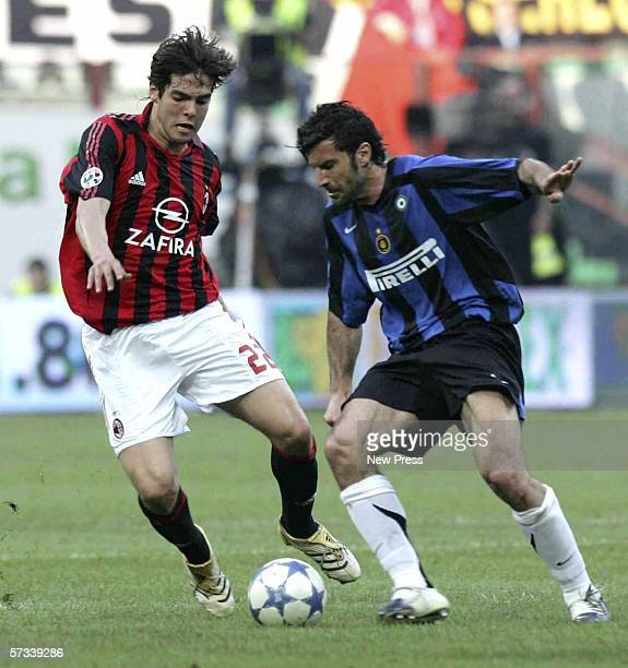Kaka of AC Milan challenges Luis Figo of Inter during the Serie A match between AC Milan and Inter Milan at the San Siro on April 14 2006 in Milan...