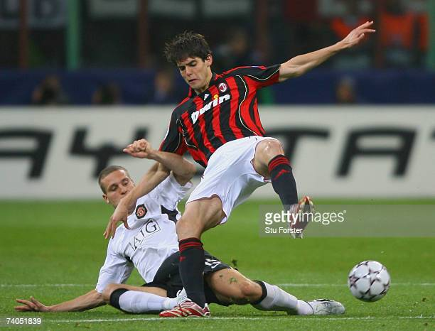 Kaka of AC Milan is tackled by Nemanja Vidic of Manchester United during the UEFA Champions League semi final second leg match between AC Milan and...