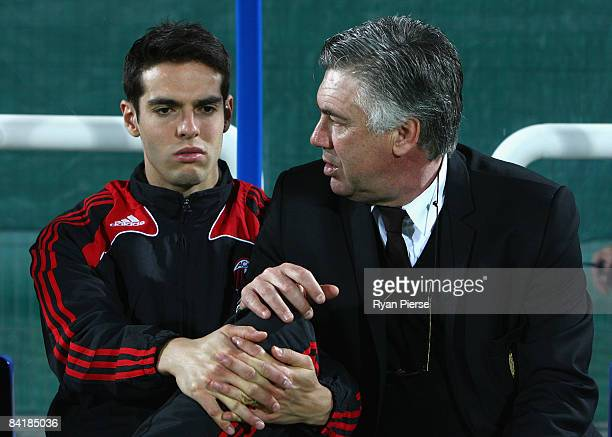 Kaka of AC Milan speaks with Carlo Ancelotti manager of AC Milan before the Dubai Football Challenge match between AC Milan and Hamburger SV at The...