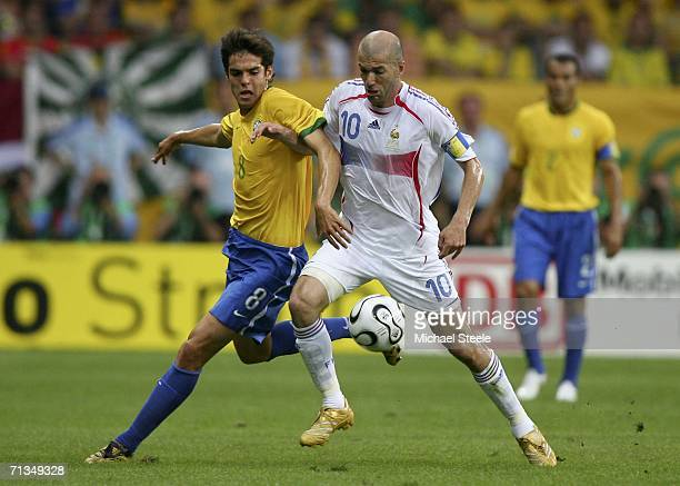 Kaka of Brazil and Zinedine Zidane of France compete for the ball during the FIFA World Cup Germany 2006 Quarterfinal match between Brazil and France...