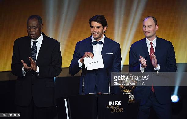Kaka of Brazil announces Lionel Messi of Argentina and Barcelona as FIFA Ballon d'Or winner with FIFA Acting President Issa Hayatou and Amaury Sport...