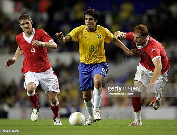Kaka of Brazil beats Carl Robinson and James Collins of Wales during the International friendly between Brazil and Wales on September 5 2006 at White...