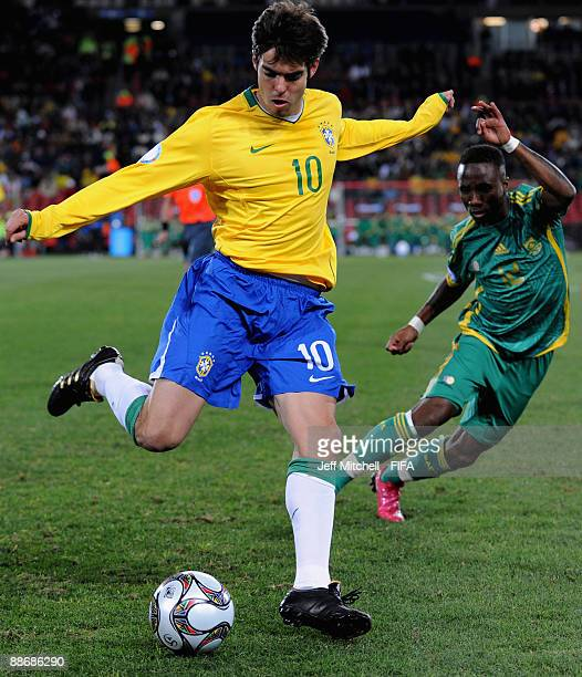 Kaka of Brazil beats Teko Modise of South Africa to the ball during the FIFA Confederations Cup Semi Final match beween Brazil and South Africa at...