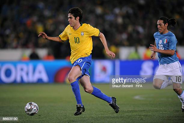 Kaka of Brazil breaks away from Mauro Camoranesi of Italy during the FIFA Confederations Cup match between Italy and Brazil at Loftus Versfeld on...