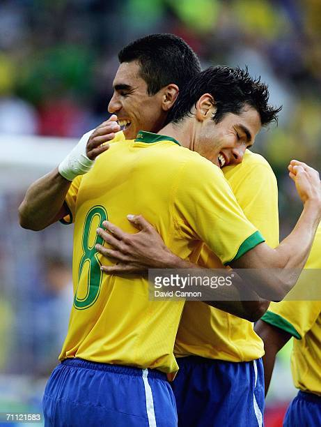 Kaka of Brazil celebrates scoring Brazil's third goal with Lucio during the international friendly match between Brazil and New Zealand at the...