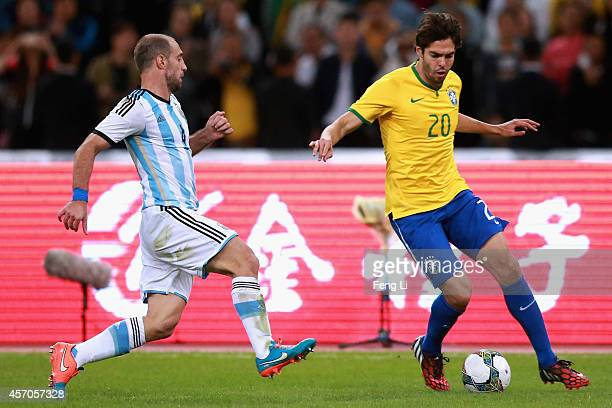 Kaka of Brazil competes the ball with Zabaleta of Argentina during Super Clasico de las Americas between Argentina and Brazil at Beijing National...