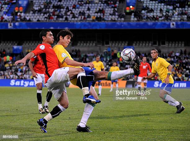 Kaka of Brazil is challenged by Ahmed Fathi of Egypt during the FIFA Confederations Cup match between Brazil and Egypt at Free State Stadium on June...