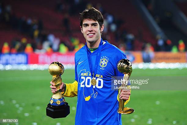 Kaka of Brazil poses with the trophy and the adidas Golden Ball awarded for the outstanding player of the tournament at the end of the FIFA...