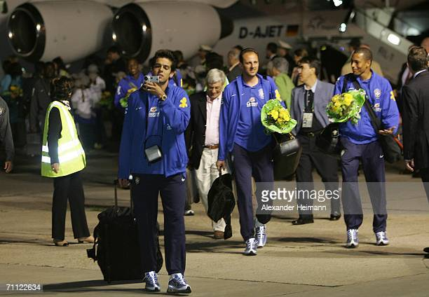 Kaka of Brazil uses a video camera as he and other members of the Brazilian national football team arrive on June 4, 2006 at Frankfurt Airport in...