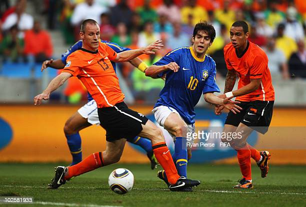 Kaka of Brazil vies for the ball with Andre Ooijer of the Netherlands during the 2010 FIFA World Cup South Africa Quarter Final match between...