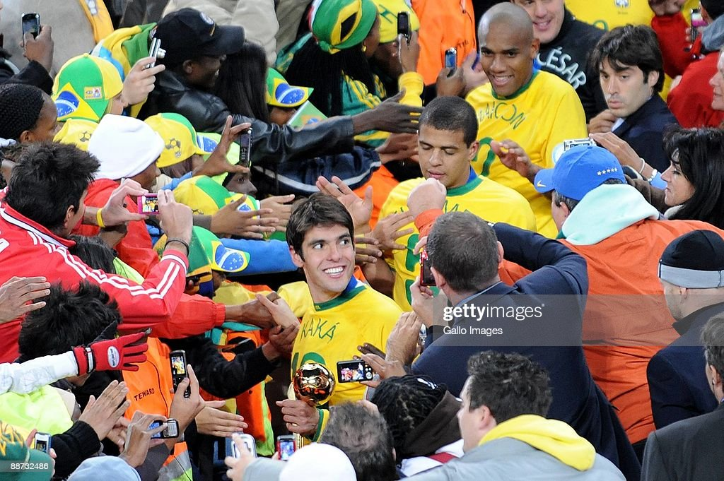 Kaka of Brazil with his teammates greet supporters after collecting their medals during the 2009 Confederations Cup final match between Brazil and USA from Ellis Park on June 28, 2009 in Johannesburg, South Africa.