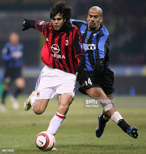 Kaka of Milan clashes with Juan Sebastian Veron of Inter during the Serie A match between Inter Milan and AC Milan played at the Giuseppe Meazza San...