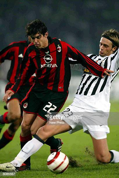 Kaka of Milan is tackled by Nicola Legrottalie of Juventus during the Juventus v AC Milan Serie A match played at the Stadio Delle Alpi March 14 2004...
