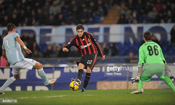 Kaka of Milan scores the 30 goal past Aleksandar Kolarov and goalkeeper Fernando Muslera of Lazio during the Serie A match between SS Lazio and AC...