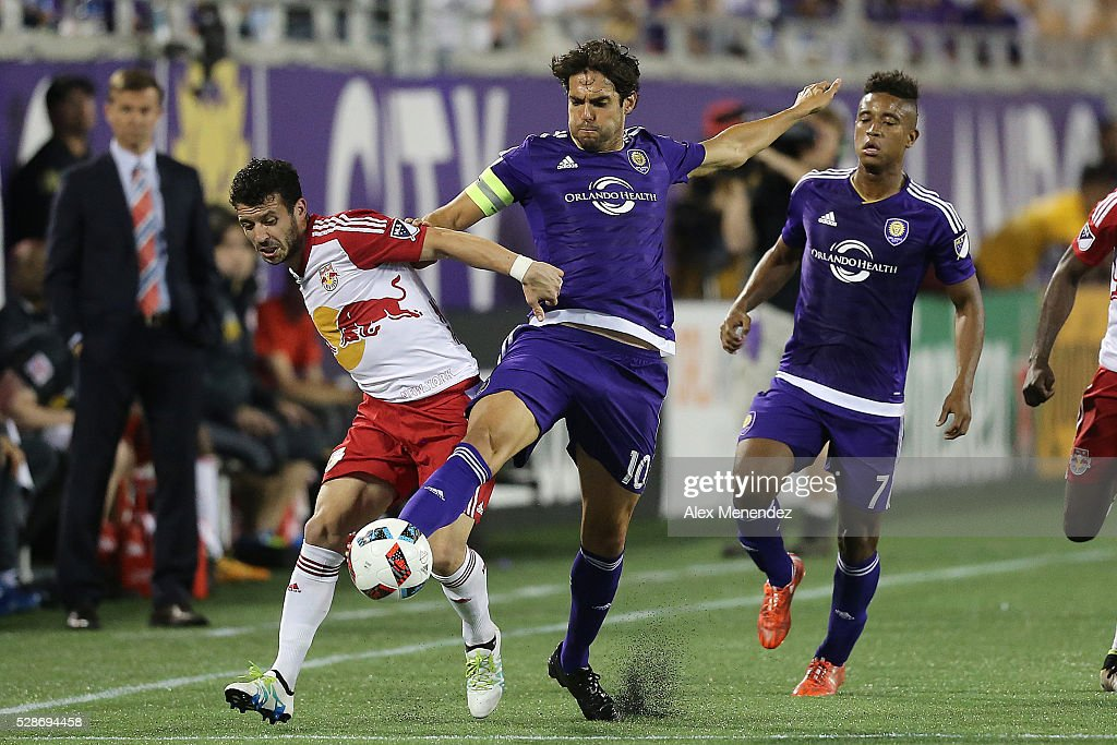Kaka #10 of Orlando City SC and Felipe Martins #8 of New York Red Bulls fight for the ball during an MLS soccer match at Camping World Stadium on May 6, 2016 in Orlando, Florida. The game ended in a 1-1 draw.
