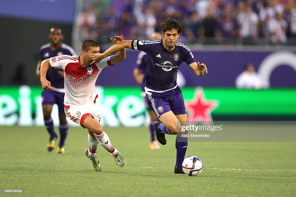 Kaka #10 of Orlando City SC and Perry Kitchen #23 of D.C. United fight for the ball during a MLS soccer match between DC United and the Orlando City SC at the Orlando Citrus Bowl on April 3, 2015 in Orlando, Florida.