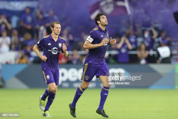 ORLANDO FL MAY 13 Kaka of Orlando City SC celebrates his goal in front of Jonathan Spector of Orlando City SC during an MLS soccer match between...