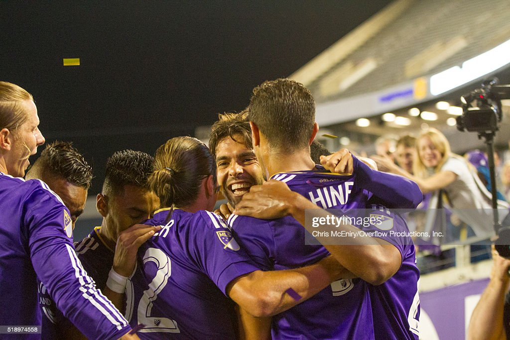 Kaka #10 of Orlando City SC celebrates with his teammate after opening the scoring with an assist to Seb Hines #3 against the Portland Timbers at Citrus Bowl on April 3, 2016 in Orlando, Florida.