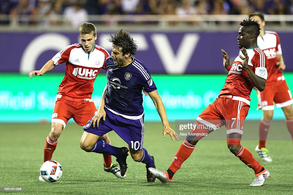 Kaka #10 of Orlando City SC gets tripped by Gershon Koffie #7 of New England Revolution during a MLS soccer match at Camping World Stadium on July 31, 2016 in Orlando, Florida.