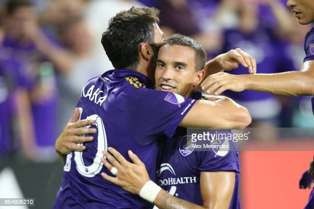 Kaka of Orlando City SC hugs Sebastian Hines after Hines scored a goal during a MLS soccer match against the New England Revolution at Orlando City...