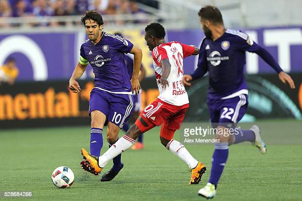 Kaka of Orlando City SC passes the ball past Lloyd Sam of New York Red Bulls during an MLS soccer match at Camping World Stadium on May 6 2016 in...