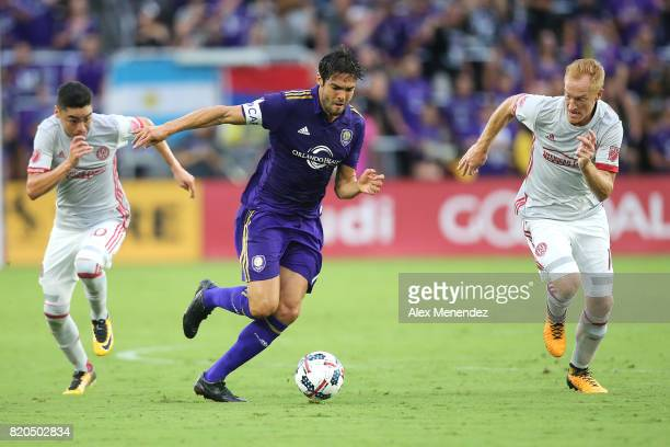 Kaka of Orlando City SC splits Miguel Almiron of Atlanta United and Jeff Larentowicz of Atlanta United during a MLS soccer match between Atlanta...