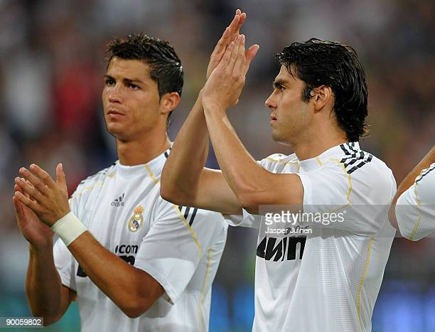 Kaka of Real Madrid applauds flanked by his teammate Cristiano Ronaldo during the Santiago Bernabeu Trophy match between Real Madrid and Rosenborg at...