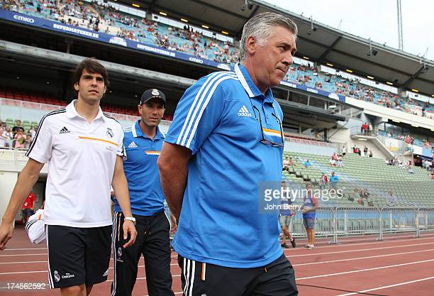 Kaka of Real Madrid assistantcoach Zinedine Zidane Carlo Ancelotti coach of Real Madrid enter the field prior to the friendly match between Real...