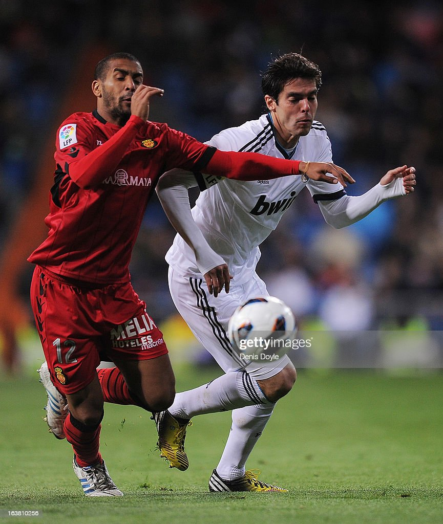 Kaka (R) of Real Madrid CF battles for the ball against Fernando Tissone of RCD Mallorca during the La Liga match between Real Madrid CF and RCD Mallorca at estadio Santiago Bernabeu on March 16, 2013 in Madrid, Spain.