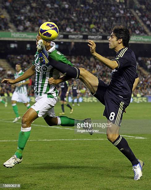 Kaka of Real Madrid competes for the ball with Angel Lopez of Real Betis during the La Liga match between Real Betis Balompie and Real Madrid CF at...