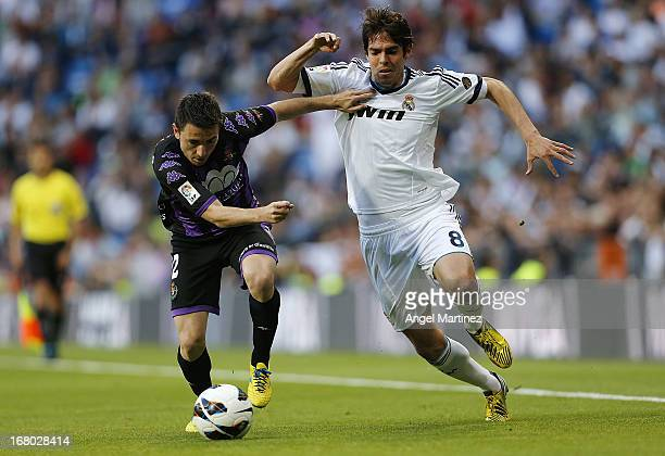 Kaka of Real Madrid competes for the ball with Antonio Rukavina of Valladolid during the La Liga match between Real Madrid and Valladolid at Estadio...