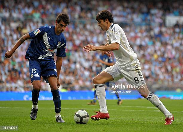 Kaka of Real Madrid duels for the ball with Roman Martinez of Tenerife during the La Liga match between Real Madrid and Tenerife at the Estadio...